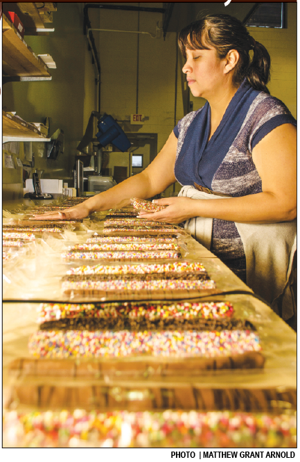 Carolina Mendez packaging chocolate covered pretzels at the David Bradley Chocolatiers Factory in West Windsor, less than three miles from Mercer's campus.