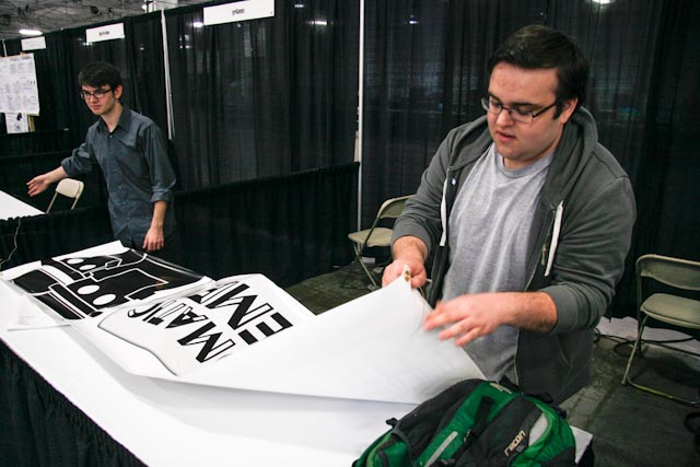 John-Paul Yunque and Matt Guido set up their booth at Too Many Games in Philadelphia. Photo by Stephen Harrison.